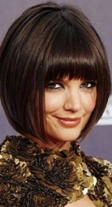 katie holmes pop hairstyle with thick bangs